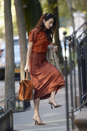 Amal Clooney in brown outfit